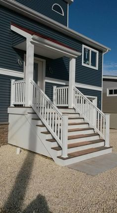 This beautiful Trex porch, was built with Great Railing white vinyl railing. Vinyl Railing, Railings, White Vinyl, Trex Decking, Porch, Mario, Stairs, Building, Beautiful