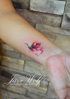 I loveeee these colors! Watercolor flower Designed and tattooed by Javi Wolf