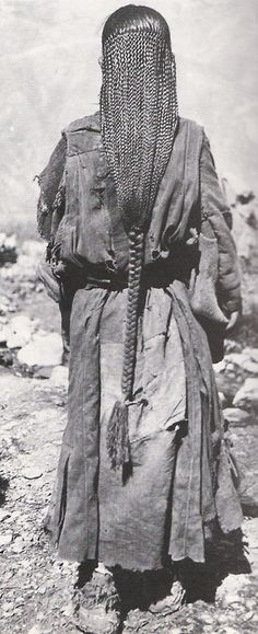 tobacco-and-leather:Tibetan women's long braided hair, many rows of brands become one at end, hair so long can sit on it, hair to knees,