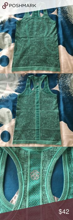 Lululemon SeaWheeze 2016 Swiftly Racerback tank 4 Lululemon swiftly racerback tank. Official color name is heathered bali breeze; it is a lovely textured teal. Worn a handful of times but simply have too much workout gear and need to part with some of it. Great gently-used condition with no rips, stains, holes, or tears. Still have the original hang tag. Sold exclusively at the 2016 SeaWheeze showcase store. lululemon athletica Tops Tank Tops