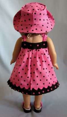 Pink and black always makes for a striking combination and thats no exception with this pretty sundress and hat duo. Sized to fit American Girl, and other 18-inch dolls, the sundress skirt features black dots on a bright pink background. The bodice and pleated ruffle showcase the reverse: pink on black. Buttons and bows accent the strap area while an inset of hot pink rick rack adds subtle detail just above the ruffle.    The dress opens all the way down the back for ease of dressing and…