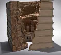 petra from http://www.hongkiat.com/blog/book-paper-sculptures/#  Amazing set of altered books/book sculpture