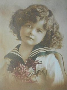 Vintage Girl With Flowers Wearing A Sailor Dress.