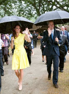 Royal raindrops! Prince William and Kate Middleton tried to stay dry as they visited a village in Honiara.