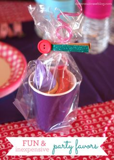 Party Favors - Each favor included: ice cream cone bubbles (3 for $1), a Loopy straw, a couple balloons and some Starbursts (what the Birthday Girl picked.) I put it all in a paper cup and tied it up with these easy glittered clothespins, made using DCWV Glitter Stack.
