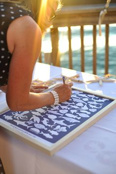 "MUST DO!!!! This would be PRECIOUS for a baby shower guest book and to have guests write a few words to Baby Lee!!! | fish inspired wedding guest ""book."""