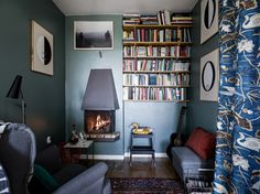 Dark blue reading corner with fireplace