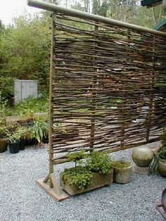 Twig privacy screen - neat way to use twigs that fall.