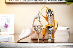 You'll need:  a pair of heeled shoes  40-50 large and medium (10-15 mm) multi-shaped rhinestones  30-40 small (3-6 mm) round rhinestones  E-6000 glue  tweezers  small dish or container  toothpick  flat nose pliers (optional)