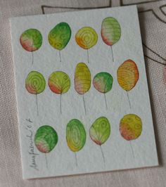 watercolor trees or make with finger prints for the front of a card
