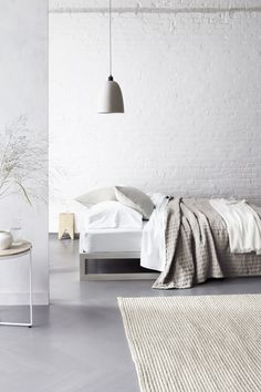 Modern Master Bedroom Interior Design - Eileen Fisher Modern Elegance Master Bedroom. Love the white throw blanket.
