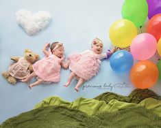 Adorable photo of two newborn cousins floating away with a bunch of balloons. sweet cute funny bear dress creative unique Baby ImaginArt by Angela Forker Precious Baby Photography Fort Wayne New Haven Indiana