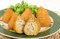 Coxinha de Galinha Brazilian breaded and deep fried snack filled with shredded chicken Stock Photo