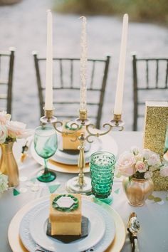 Green glassware and mismatched white plates with gold and glitter. love it.