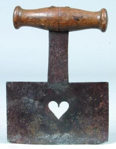 "Iron Blade Food Chopper having heart cut-out on blade and wooden hand handle, 6 ½""h."