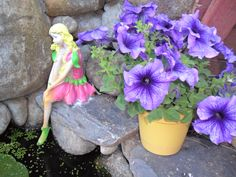 Carla, my garden fairy resting by the pond