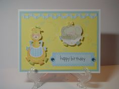 Birthday Card for Baby with Animal Cut Outs in Yellows and Blues