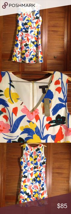 Floral J. Crew Dress PRICE FIRM A line, fit and flare style dress.  Zipper back. White with a multi colored floral print. V-neck. Hits at the knee. New with tag- never worn! J. Crew Dresses Mini