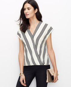 We mixed bold stripes with refined color to create this newest can't-live-without topper. V-neck with crossover front and hidden snap closure. Cap sleeves. Back shirttail hem.