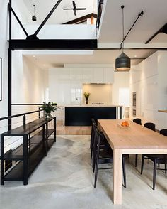 """""""Black painted beams and natural wood give a nice contrast in this #minimalist 3-story #warehouse-turned-#home. Design by @technearchitects \\\ Photo by…"""""""