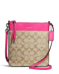"""- Signature fabric with leather trim - Zip-top closure, fabric lining - Inside multifunction pockets - Outside pocket - Adjustable strap for shoulder or crossbody wear - 7 3/4"""" (L) x 8 1/4"""" (H) x 1"""" ("""