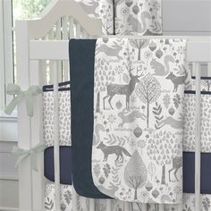 """Baby Blanket in Navy and Gray Woodland by Carousel Designs.  Our soft and lightweight crib blanket is just the thing to wrap your baby up, snug as a bug in a rug. At 34"""" x 43"""", it's the perfect size for the newest addition to the family."""