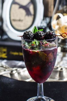 Blackberries, fresh mint leaves, white rum, and cranberry juice combine for a dark, delicious ode to Poe. Get the recipe at Smarty had a Party.