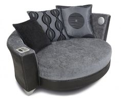 Squishy musical madness as your sofa becomes a speaker dock - DFS has taken furniture and iPod audio docks to their logical, mashed-up conclusion with the Trophy Cuddler Audio Sofa, a two-person chair for those who daren't snuggle without musical accompaniment. The iPod Cuddler Chair has not only a dock to recharge your Apple PMP and funnel its music out through its stereo speakers and bottom-shuddering subwoofer, but a USB port and Bluetooth too. | #Gadgets #Docks #AudioSofa #Furniture |
