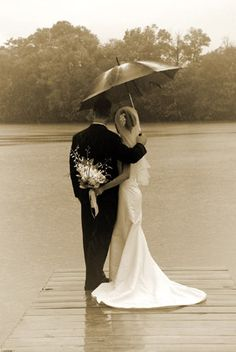 I would not want my wedding dress wet, but this picture is adorable :) try a sunny day!