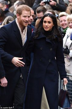 Miss Markle was wearing a dark blue coat as the newly-engaged couple spoke and posed for photos with the onlookers