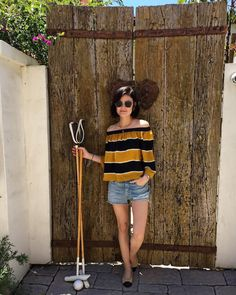 Lucy Hale cute summer outfit. Jean shorts and off the shoulder top.