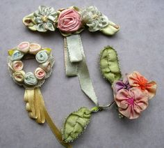 """Antique French Ribbon Roses Flower Trim Embellishments from the 1920's era.  They are quite old and do have some fading and fraying.  They are backed with a material that is like stiffened gauze.  Measure: wreath - 1-1/4"""" x 3""""; two flowers - 1-1/2"""" wide x 1-1/2"""" long; 3 flower with rose center - 2-3/4"""" wide x 3"""" long."""
