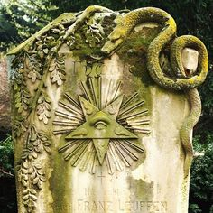 This is a headstone from 1900. The snake and olive branches are symbolic of the…