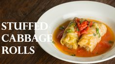 Delicious and savory stuffed cabbage rolls served in a delicate tomato based sauce, perfect food for a potluck or dinner party on a cold day! For the complet...