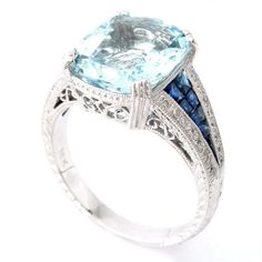 Love the large light aquamarine center stone! Blue sapphire and aqua ring from Beverley K