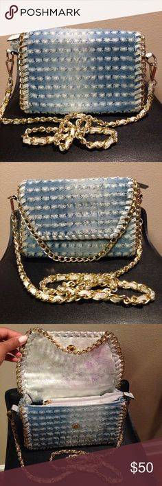 Denim purse w/ gold chain strap & details. Very cute denim purse. Gold chain cross-body strap. Steal can be removed. Used. Some light dirt spots from wear but can be cleaned. Bags Crossbody Bags