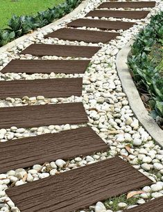 Recycled Rubber Railroad Tie Stepping Stone Design a unique pathway, patio or landscape accent with our recycled rubber stepping stones. The shape and texture mimics real railroad ties. Garden Steps, Diy Garden, Garden Paths, Garden Bed, Shade Garden, Landscaping With Rocks, Front Yard Landscaping, Backyard Landscaping, Railroad Ties Landscaping