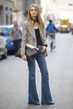 15 Incredibly Cool New Ways to Wear Your Favorite Jeans Right Now. Channel that '70s vibe with tailored flares, a classic blazer, and neck scarf.