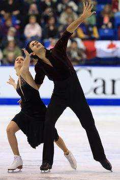 SAINT JOHN, NB - OCTOBER 26:  Kaitlyn Weaver (L) and Andrew Poje of Canada skate during the ice dance free program on day two at the ISU GP ...