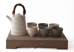 Teapot and six cups by Julian Stair. Muted, sophisticated and clean.