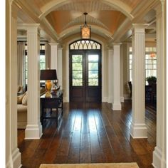 plantation home entry with buffet separating the rooms between columns