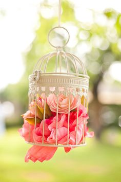 Fab birdcage decorations at this summer wedding