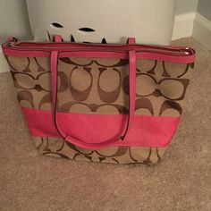 Coach tote with wristlet! Coach pink and brown tote bag. The bag is loved so it has some minor stains on the outside and inside so I am throwing in the wristlet for free!! Coach Bags Totes