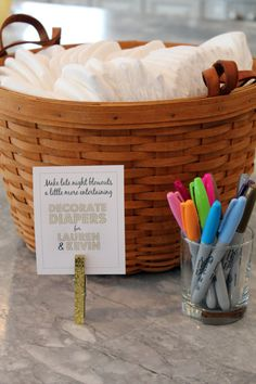 Have baby shower guests decorate diapers with permanent markers.