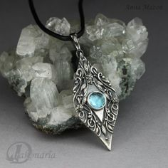 Blue song - elven pendant with blue topaz. jewelry by drakonaria, via Etsy.