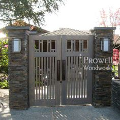 "#38-1 as Double Garden Gates in Santa Rosa, California. Because of the wonderful, but irregular stone, the jambs were mounted to the column's block core. A measurement was provided from the block to the outermost edge of the stone. Prowell created jambs that were 1/2"" thicker than the provided dimension, allowing free swing and preventing the gate from striking or binding on the stone. -- Our overall opening is 79"", and at a height of 83""."