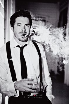 Pink Posh Photography   Austin Texas Outdoor Wedding   Barr Mansion   Groom Portraits   Groom with suspenders cigar and scotch
