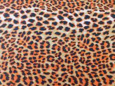 Viscose Toque de Seda Onça Laranja disponível em nossa loja ! Em até 6x sem juros e enviamos para todo Brasil, aproveite !  https://www.luematecidos.com.br/viscose-estampada/viscose-toque-de-seda-onca-laranja.html
