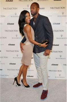 """Gabrielle Union and Dwayne Wade - At Maserati Ghibli Unveiling in Miami, FL.  (November 2013). Notice his incredibly large hand is gripping her butt cheek, which clearly means, """"she's mine!"""" LOL."""