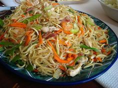 filipino pancit... so delicious, when i make it for people, they like me more than they did before i served them this dish.